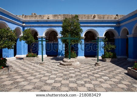 Blue painted cloisters of the Claustro los Naranjos inside the historic Monasterio de Santa Catalina in Arequipa, Peru - stock photo