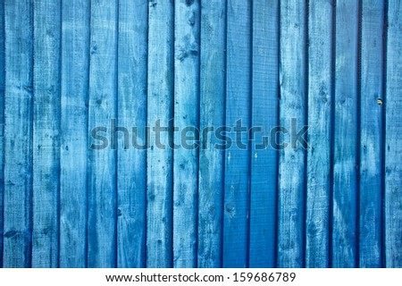 Blue painted fence as a a background image