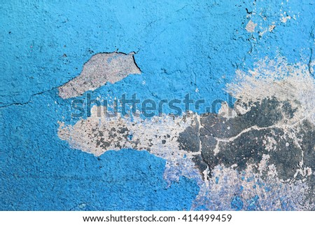 Blue painted grunge concrete wall. Weathered peeling paint texture. Blue weathered background. Bright blue paint texture, cracked over time. - stock photo