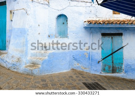 Blue painted walls of the houses in Chefchaouen small town in northwest Morocco famous by & Blue Painted Walls Houses Chefchaouen Small Stock Photo (Royalty ...