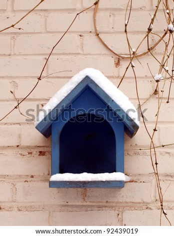 Blue painted wooden bird house - stock photo