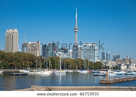 blue panoramic skies above Toronto CN Tower overlooking the luxury high rise apartments along the harbour waterfront of Lake Ontario, Toronto, Canada. - stock photo