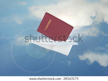 Blue paper airplane flight and passport - stock photo