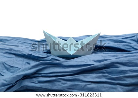 Blue paper boat, origami boats - stock photo