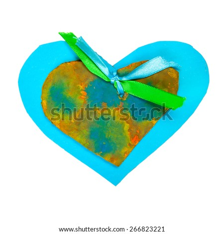 Blue paper heart shape with green ribbon isolated on white - stock photo