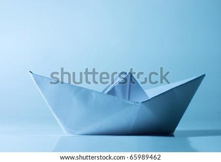 Blue paper ship - stock photo
