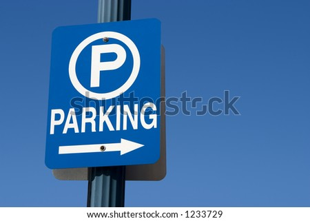 Blue parking sign against a blue sky.