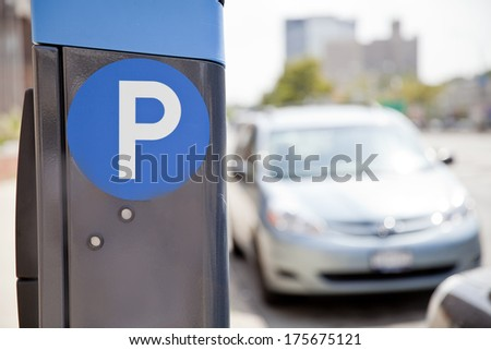 Blue parking sign with blurred cars at the background in New York City - stock photo