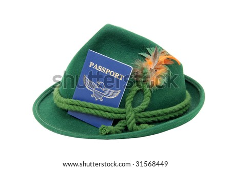 Blue passport needed when traveling between borders tucked into an alpine hat - path included - stock photo