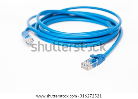 Blue patchcord with RJ45 plug lan network - stock photo