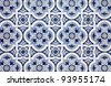 Blue pattern detail of Portuguese glazed ceramic tiles. - stock photo