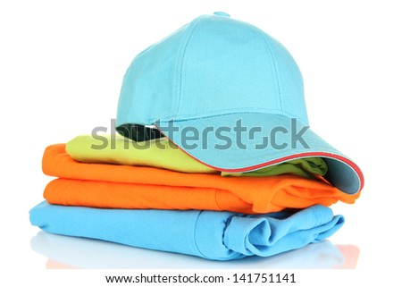 Blue peaked cap with T-shirts isolated on white - stock photo
