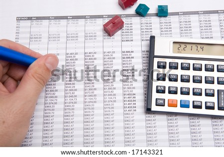 blue pen and small house on the sheet - stock photo
