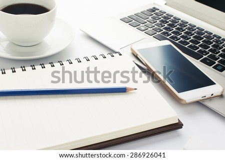 Blue pencil with Book and cup of coffee on white background - stock photo