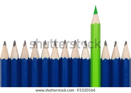 Blue pencils and one green crayon standing out from the crowd. Isolated on white. - stock photo