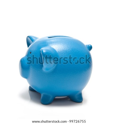 Blue piggy bank or money box isolated on a white studio background. - stock photo