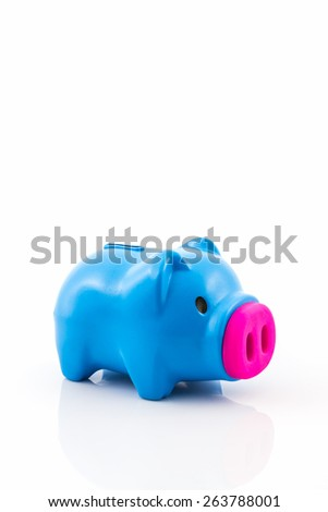 Blue piggy bank saving on white background. - stock photo