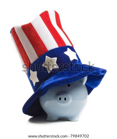 Blue piggy bank wearing patriot hat. Saving for the tax - stock photo