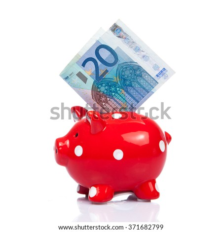 blue Piggy bank with 20 Euro bill. 20 Euro note - stock photo