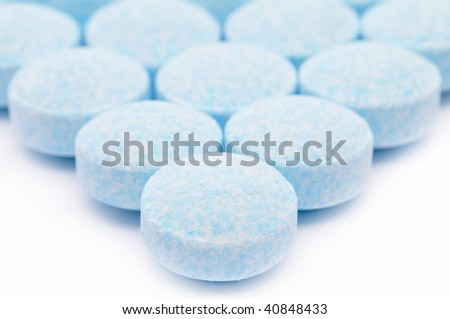 blue pills against white background