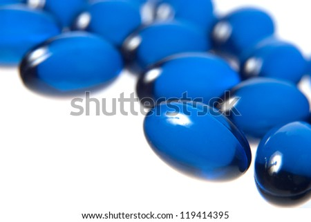 Blue pills isolated on white