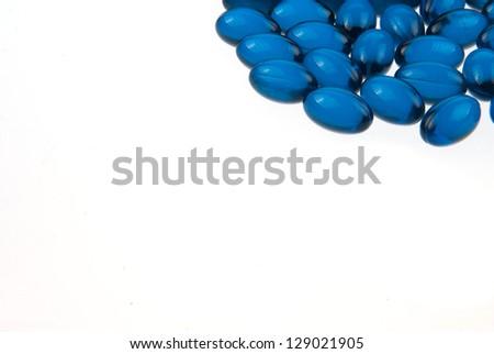 Blue pills macro isolated on white background - stock photo