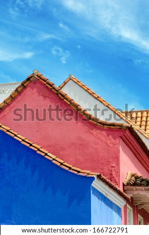 Blue, pink, and white colonial buildings in the old town of Cartagena, Colombia - stock photo