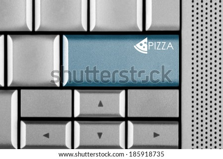 Blue PIZZA key on a computer keyboard with clipping path around the PIZZA key - stock photo