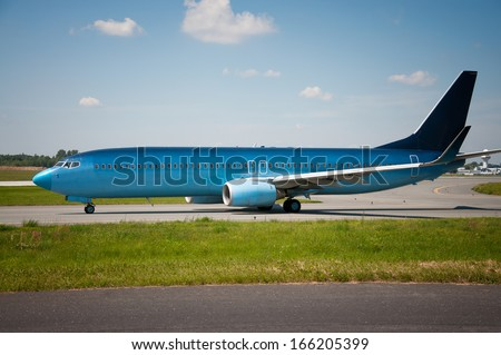 blue plane on the runway - stock photo