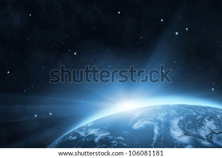 Blue planet Earth with bright sunrise in the space - stock photo