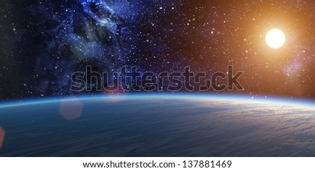 Blue planet with bright star on nebula background. With lens flare.