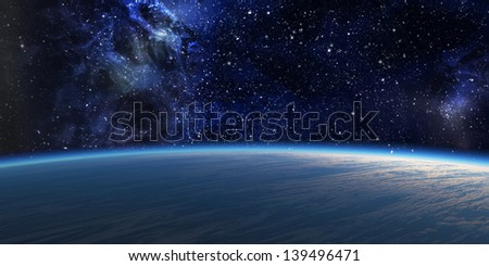 Blue planet with nebula on background. - stock photo