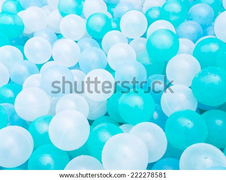 Blue plastic ball with water drops - stock photo
