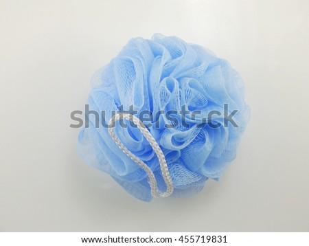 blue plastic bath puff for shower cleaning and scrub body - stock photo