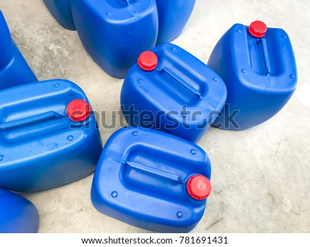 Blue plastic container size 30 liters for contain liquid is in the warehouse.