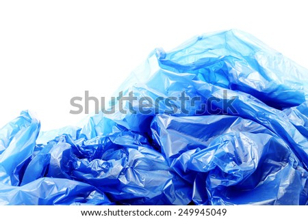 Blue plastic garbage bags on a white background - stock photo