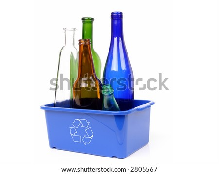 Blue plastic garbage bin with white recycle symbol containing colorful glass bottles - over white background - stock photo