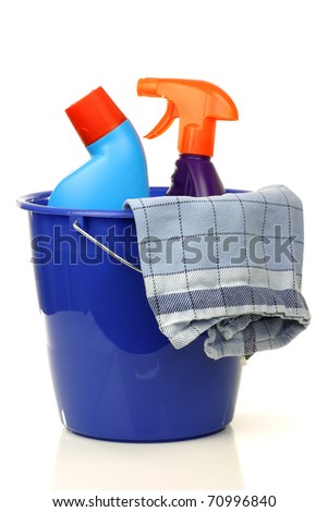 blue plastic household bucket with two cleaning bottles and a household towel on a white background - stock photo