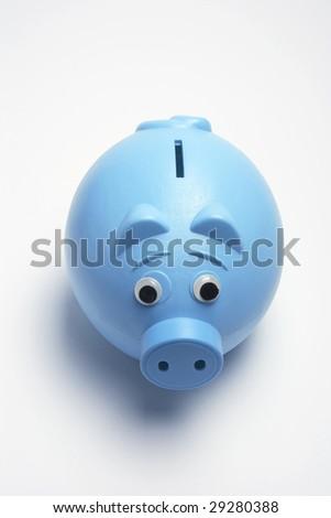 Blue Plastic Piggy Bank on Seamless White Background - stock photo