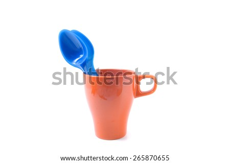 Blue plastic spoon in the brown cup   - stock photo