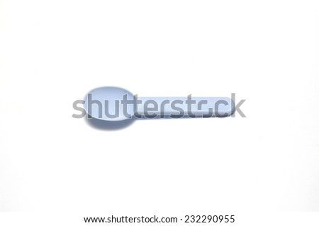blue plastic spoon on a white background - stock photo