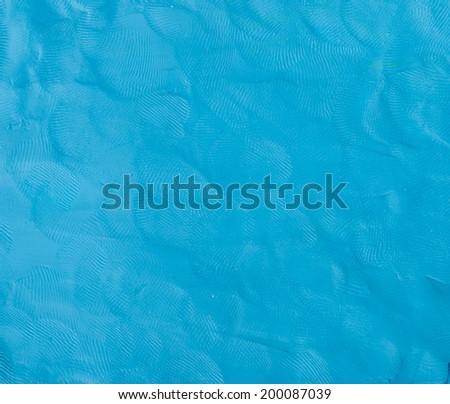 Blue Plasticine finger textured background. - stock photo