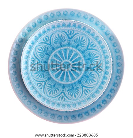 Blue plate isolated on white - stock photo