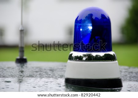 blue police light shining on an old police car in Denmark - stock photo