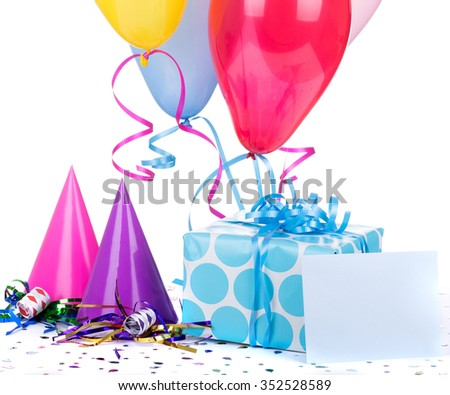 Blue polka dot present and envelope with birthday hats and balloons on a white background
