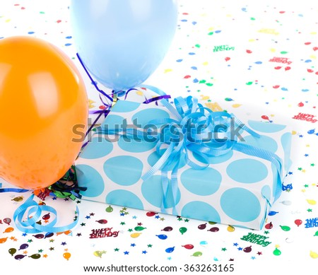 Blue polka dot present balloons and confetti on a white background