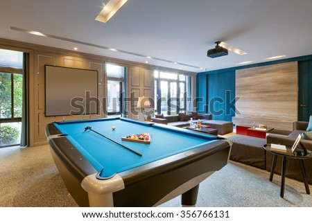 blue pool in luxury recreation room - stock photo