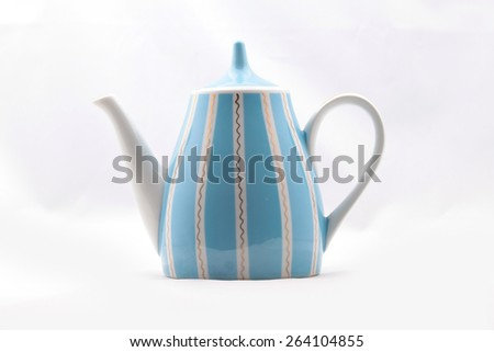 Blue porcelain teapot - stock photo
