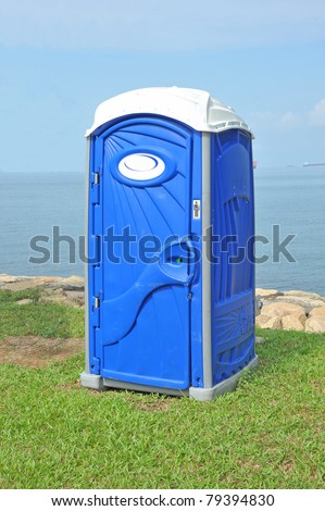 Blue Portable Toilet In The Park - stock photo