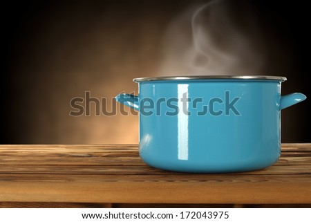blue pot and empty space on desk  - stock photo